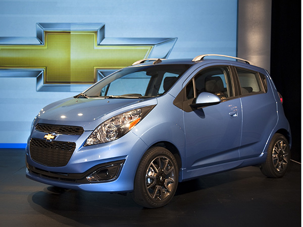 Chevrolet Spark car hire (left) from  Val & Kar Rent a car